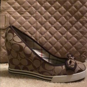 Never worn Coach wedge shoes